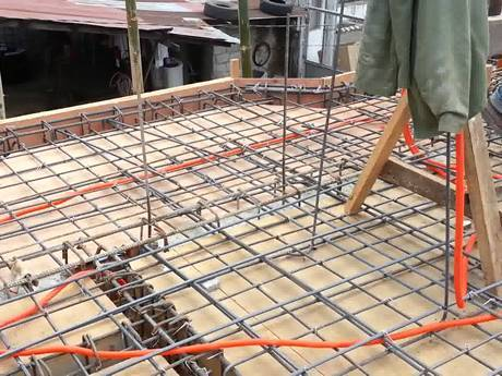 The second floor covered with reinforcing rib mesh waiting for building.