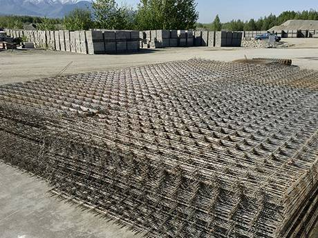 Concrete reinforcing meshes are placed at a factory.