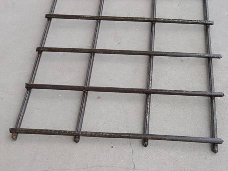 A sheet of reinforcement welded mesh with square openings.