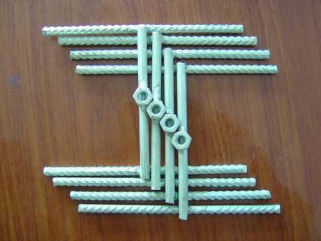 Twelve Short Pieces Of Blue Galvanized Reinforcing Steel Bars With Four Hexagon Nuts